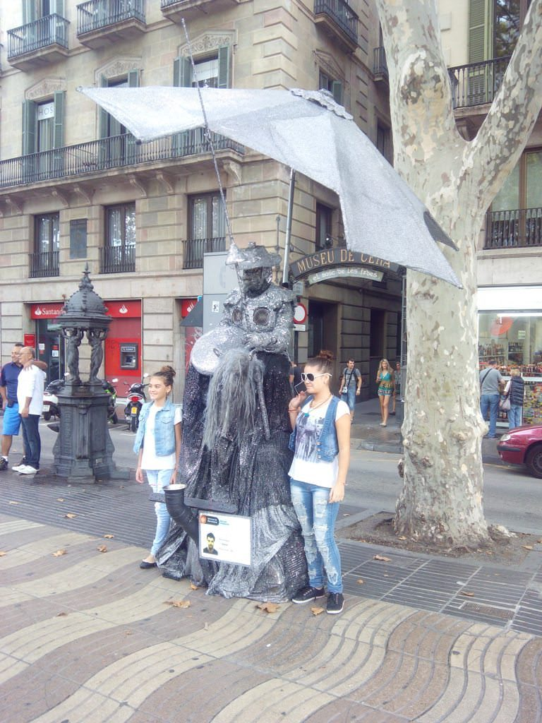 Human Statues or street beggars in Barcelona dressed up as yoshimitsu